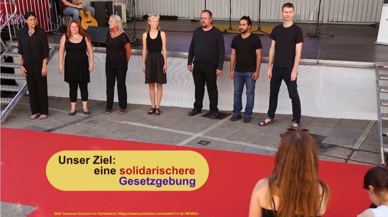 SommerSonnen Go Parliament und versuchen so, eine solidarischere Gesetzgebung zu erwirken